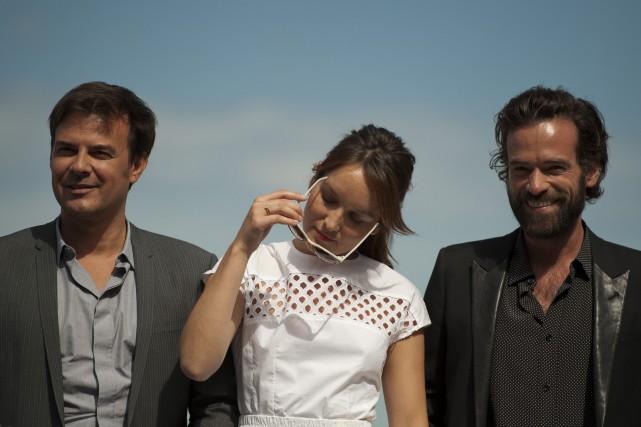 François Ozon (à gauche), pose pour les photographes... (PHOTO ARCHIVES AP)