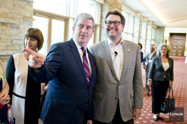 Les ministres de l'Environnement des deux provinces, David... (Photo MARTIN ROY, Le Droit)