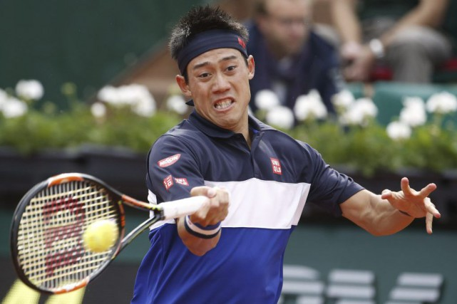 Kei Nishikori... (PHOTO KENZO TRIBOUILLARD, AFP)