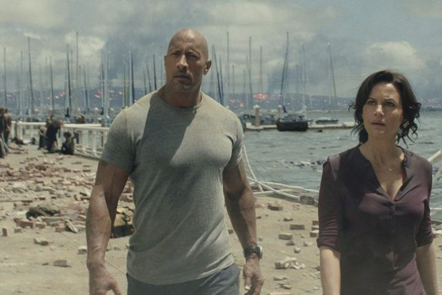 Dwayne «The Rock» Johnson et Carla Gugino dans... (Jasin Boland)