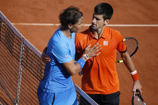 Novak Djokovic (à droite) est devenu le deuxième... (Photo Kenzo Tribouillard, AFP)
