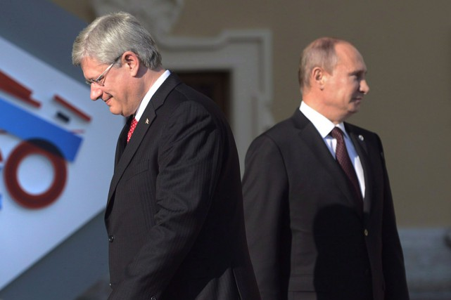 Stephen Harper et Vladimir Poutine... (PHOTO ARCHIVES LA PRESSE CANADIENNE)