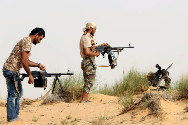 Des combattants de la miliceFajr Libya... (PHOTO MAHMUD TURKIA, AFP)