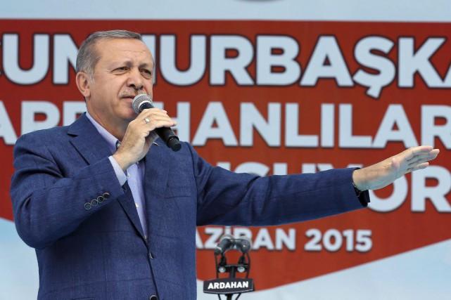 Même s'il n'est pas candidat, Recep Tayyip Erdoganjoue... (Photo AP)