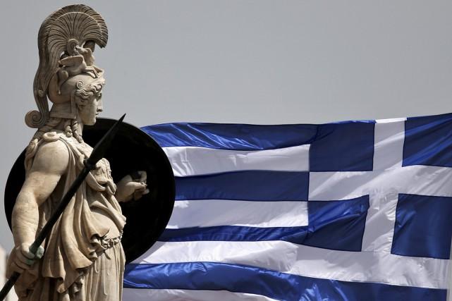 Soumise à une rigoureuse austérité en échange de... (PHOTO ALKIS KONSTANTINIDIS, REUTERS)