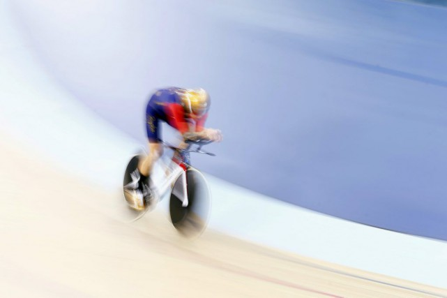 Bradley Wiggins... (PHOTO ANDREW WINNING, REUTERS)