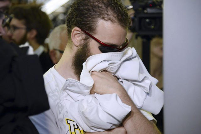 Un membre de Forsane Alizza se cache le... (PHOTO BERTRAND GUAY, AFP)