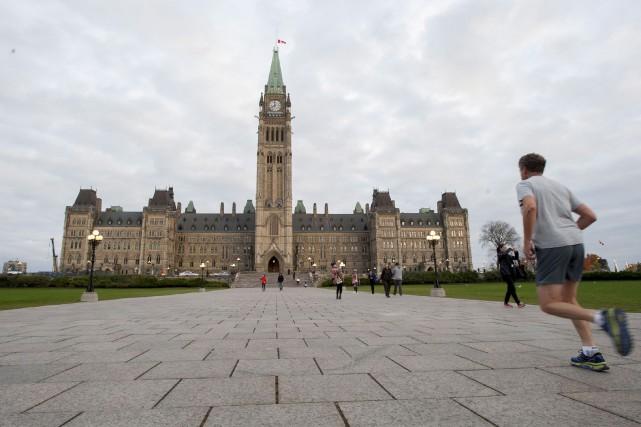 Deux députés libéraux, Massimo Pacetti et Scott Andrews,... (Photo Justin Tang, archives La Presse Canadienne)
