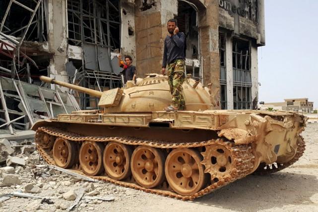 Essentiellement implanté jusque-là en Syrie et en Irak,... (Photo: Reuters)