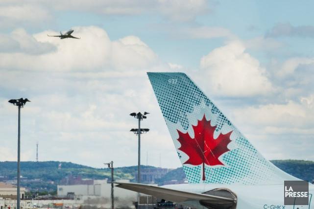 Air Canada a lancé une enquête, lundi, après avoir été informée que plusieurs... (ÉDOUARD PLANTE-FRÉCHETTE, ARCHIVES LA PRESSE)