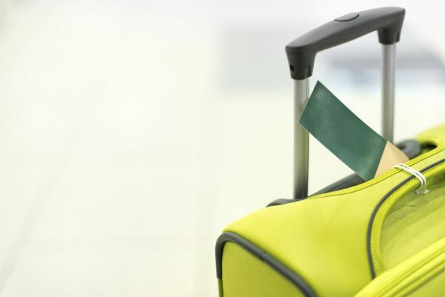 Selon l'IATA,le bagage en cabine parfait mesure55 centimètres... (Photos.com)