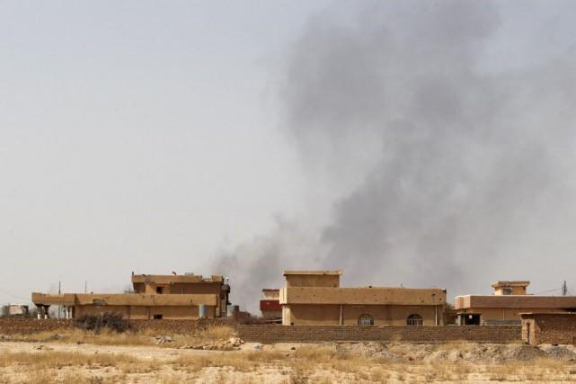 La coalition contre le groupe Etat islamique menée... (PHOTO AHMAD AL-RUBAYE, AFP)