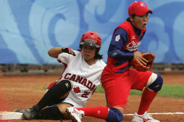 Le softball féminin aété éliminé du programme olympique... (Photo Jessica Rinaldi, archives Reuters)