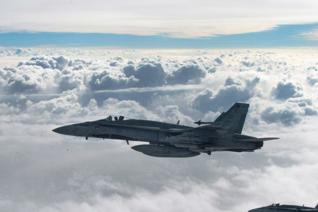 Deux CF-18 ont mené une attaque contre le... (PHOTO ARCHIVES LA PRESSE CANADIENNE/AVIATION ROYALE CANADIENNE)