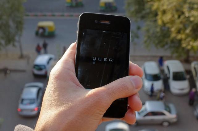 Le service américain de réservation de voiture avec chauffeur Uber a annoncé... (PHOTO ARCHIVES AFP)
