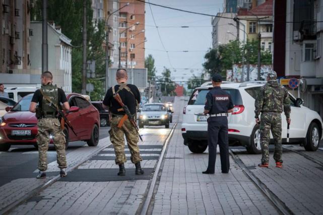 Le conflit dans l'Est a conduit à une... (PHOTO ANDREY BORODULIN, AFP)
