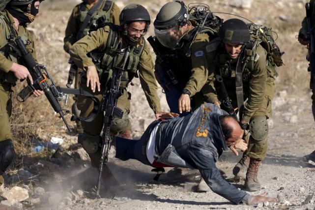 «La conduite de ces soldats n'est apparemment pas... (Photo: Reuters)