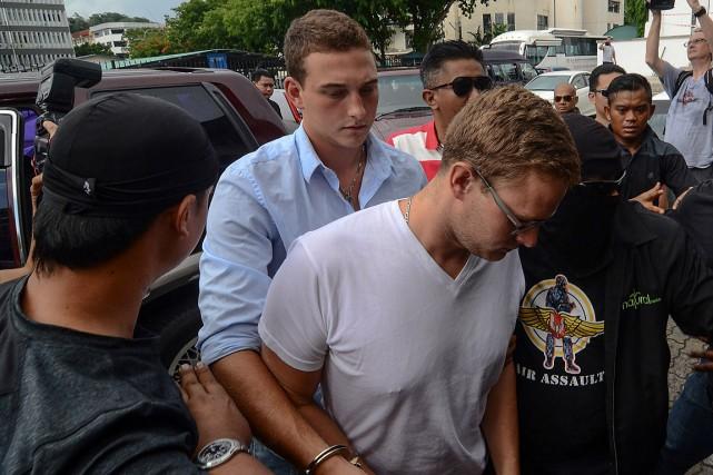 Danielle Petersen (centre-gauche) et sa soeuront été condamnés... (PHOTO AFP)