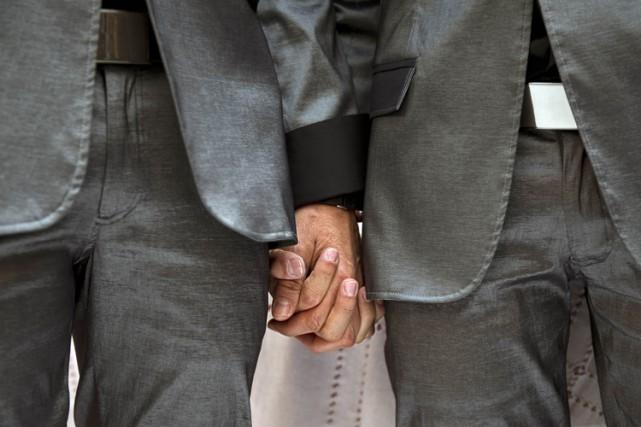 La communauté gaie et lesbienne célébrait lundi une décision de la Cour suprême... (Photo: AFP)