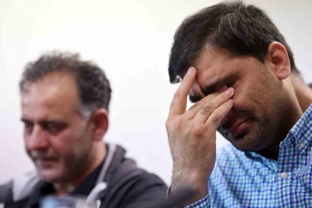 Akhtar Iqbal (à gauche) etMohammed Shoaib (à droite).... (PHOTO PAUL ELLIS, AFP)