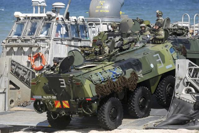 Le scénario de l'exercice prévoit la défense d'un... (Photo: AFP)