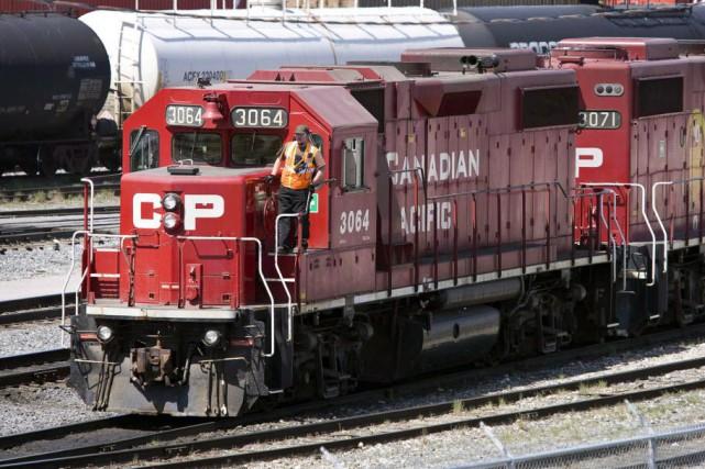 Les milieux financiers voient de gros bénéfices potentiels... (Photo Jeff McIntosh, archives La Presse Canadienne)