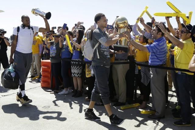 Le défilé des champions aura lieu vendredi matin,... (PHOTO AP)
