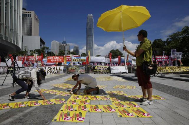 Les divisions politiques ont éclaté au grand jour... (Photo Kin Cheung, AP)