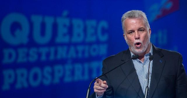 Dimanche dernier, le premier ministre du Québec, Philippe... (PHOTO GRAHAM HUGHES, LA PRESSE CANADIENNE)