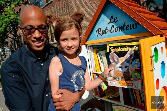 Aly Ndiaye, alias Webster, et la petite Mia... (Photo Le Soleil, Erick Labbé)