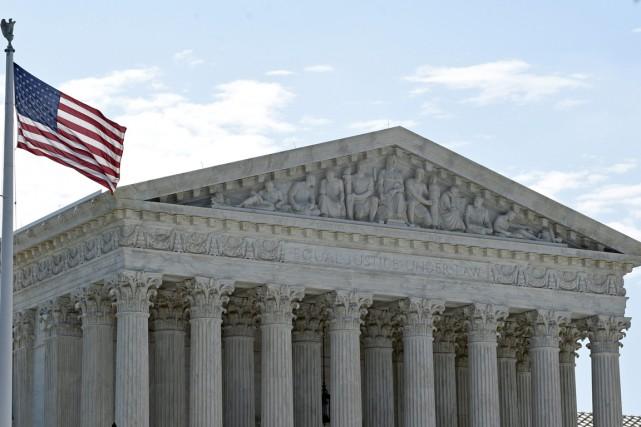 Dans une décision de cinq juges contre quatre,... (PHOTO SUSAN WALSH, AP)