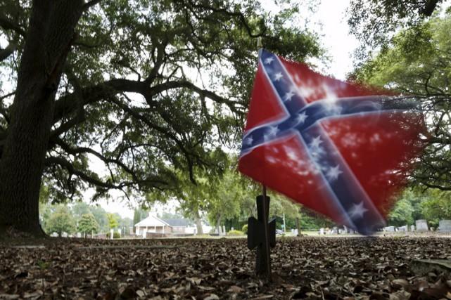 Symbole de valeur et d'honneur pour les uns, d'esclavagisme et de violence... (PHOTO REUTERS)