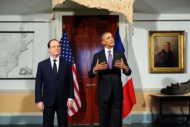 Le président américain Barack Obama aux côtés du... (Photo archives AFP)