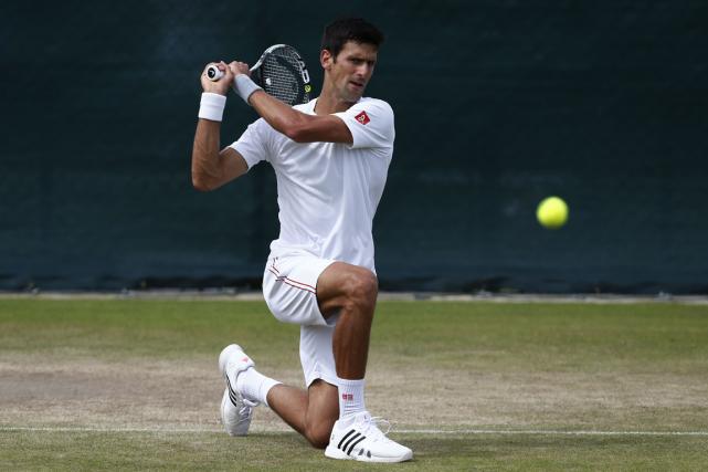 Novak Djokovic partira favori chez les hommes à... (Photo Justin Tallis, AFP)