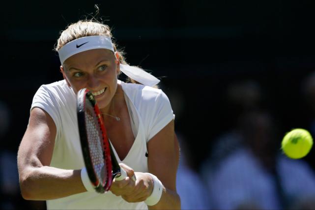 La championne en titre de Wimbledon Petra Kvitova... (Photo Tim Ireland, AP)