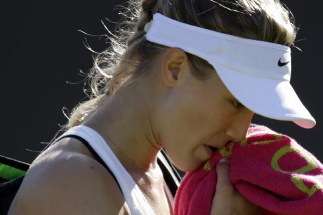 Eugenie Bouchard après sa défaite à Wimbledon... (AP, Pavel Golovkin)