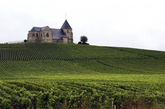 Les coteaux, maisons et caves de Champagne correspondent... (PHOTO ALAIN JULIEN, ARCHIVES AFP)