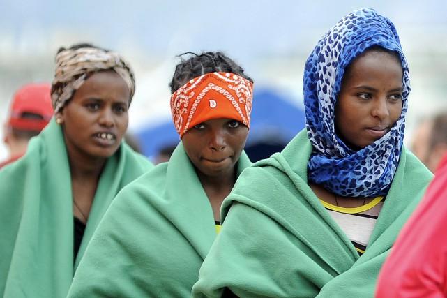 Un tiers des hommes, femmes et enfants qui... (Photo Guglielmo Mangiapane, Reuters)
