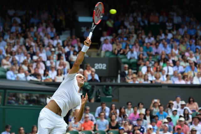 Le numéro 2 mondial Roger Federera surclassé l'Américain... (Photo Glyn Kirk, archives AFP)