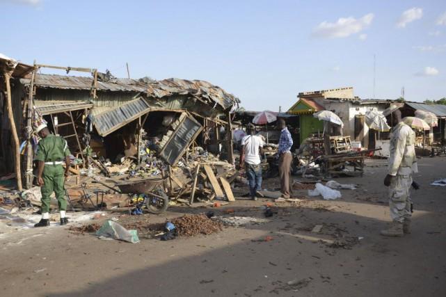 En tout, plus de 400 personnes ont péri... (Photo Jossy Ola, AP)