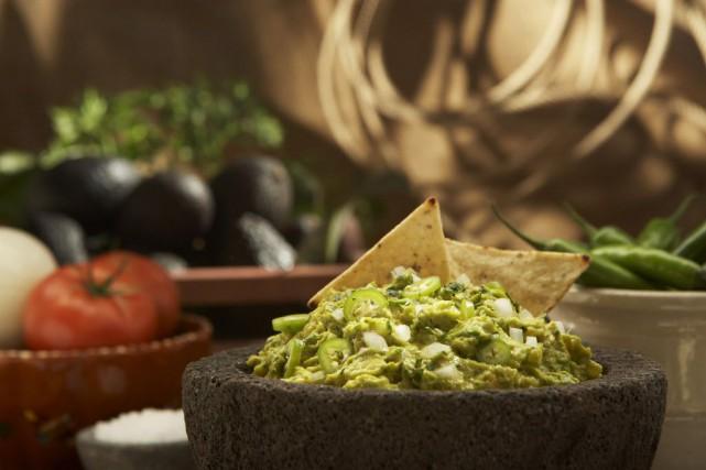 La recette classique du guacamole contient avocat, oignon,... (Photo archives La Presse canadienne)