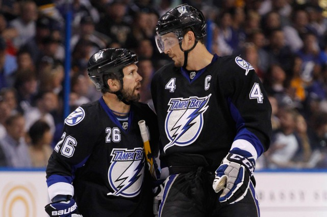 Martin St-Louis et Vincent Lecavalier ont été coéquipiers... (PHOTO MIKE CARLSON, ARCHIVES REUTERS)