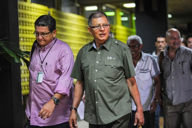 Après une pause de six jours, les négociateurs... (PHOTO YAMIL LAGE, AFP)