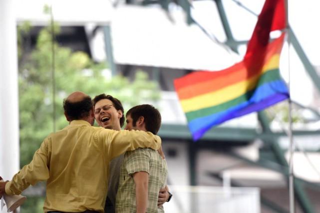 La Cour suprême a légalisé le mariage gai... (Photo Adam Lau / Knoxville News Sentinel via AP)
