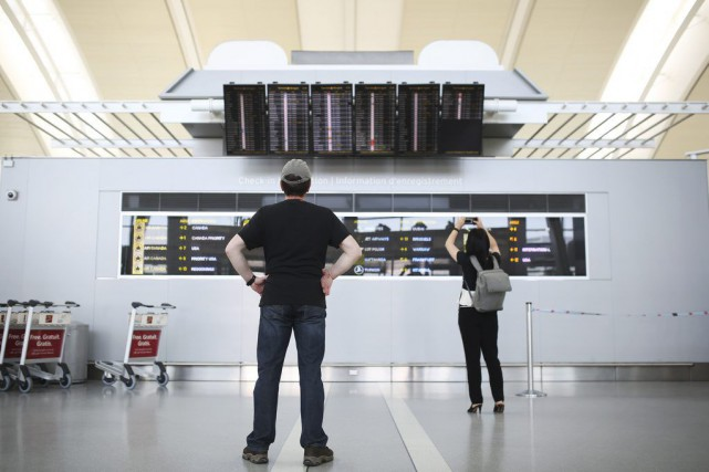 Air Canada indique que les clients touchés par... (Photo Cole Burston, Toronto Star)