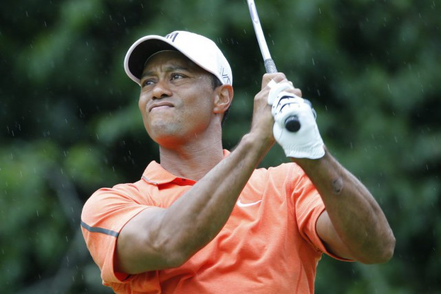 Tiger Woods... (PHOTO STEVE HELBER, AP)