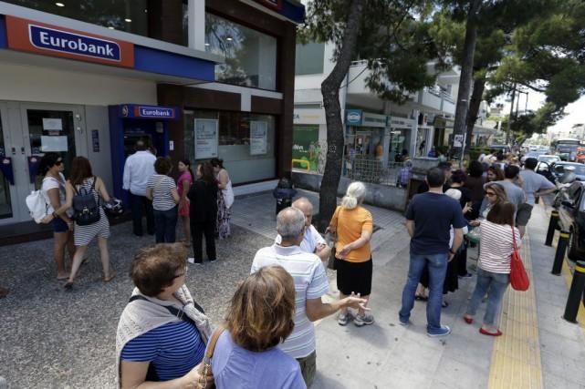 Les banques en Grèce sont fermées depuis le... (AP,Thanassis Stavrakis)