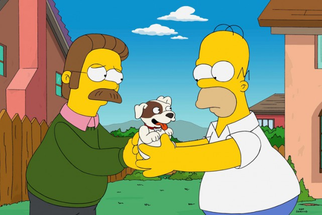 Ned Flanders et son voisin Homer Simpson.... (AP)