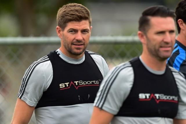 Steven Gerrard et Robbie Keane lors d'un entraînement... (PHOTO AFP)