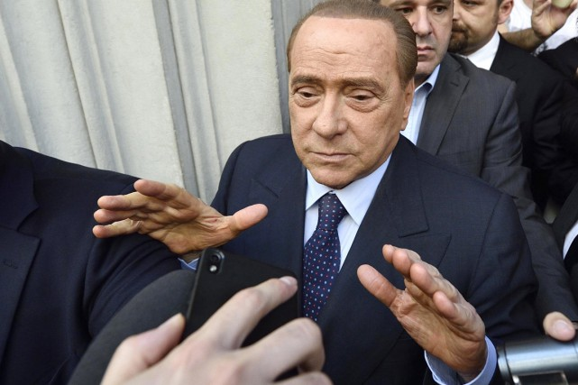 Silvio Berlusconi... (PHOTO FLAVIO LO SCALZO, ARCHIVES AP)